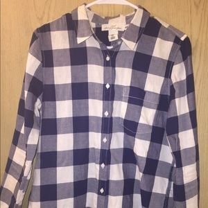 Blue and white checkered flannel shirt